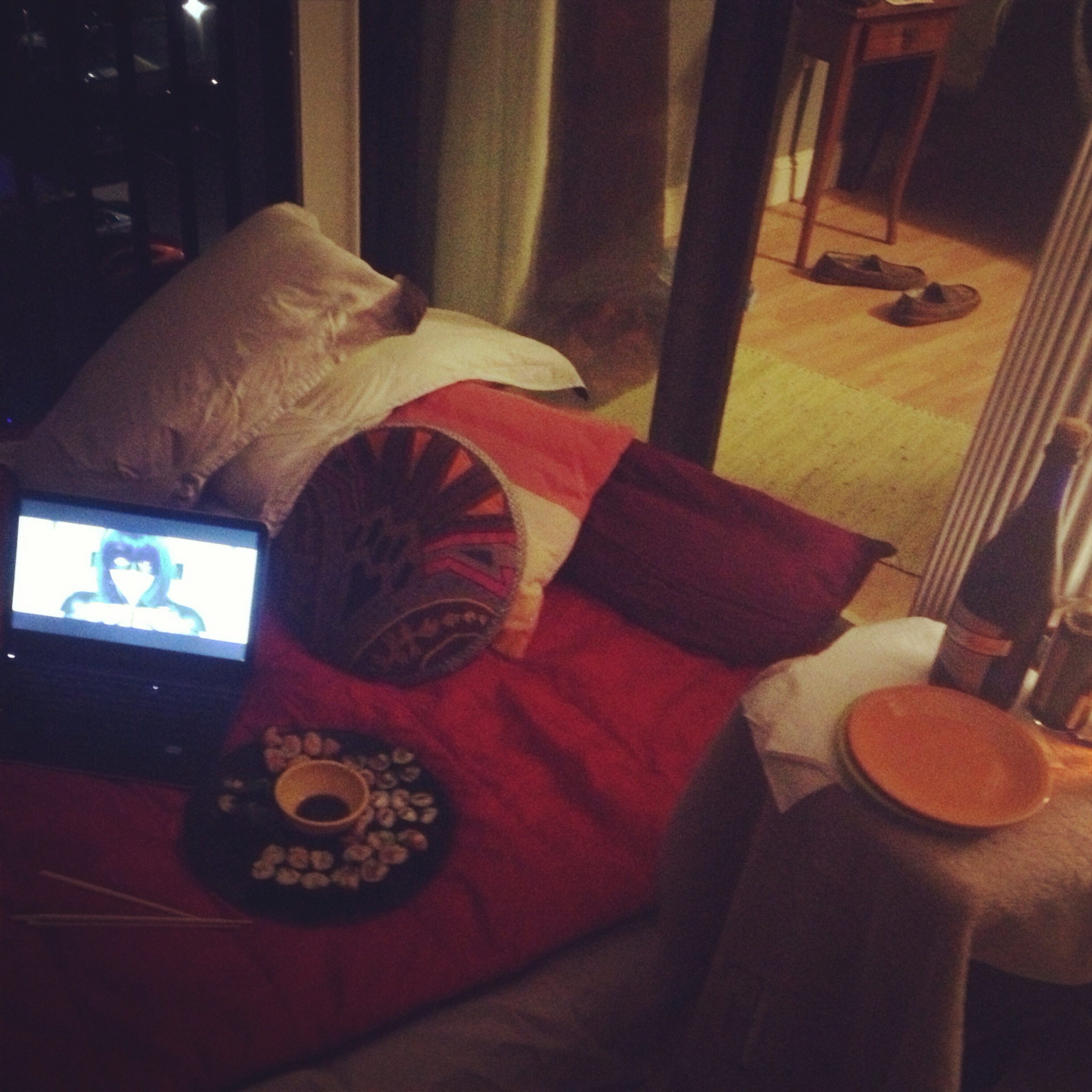 Our NYE ritual -- homemade sushi, Prosecco, an air mattress, all the pillows we have. the balcony + a movie on the laptop.